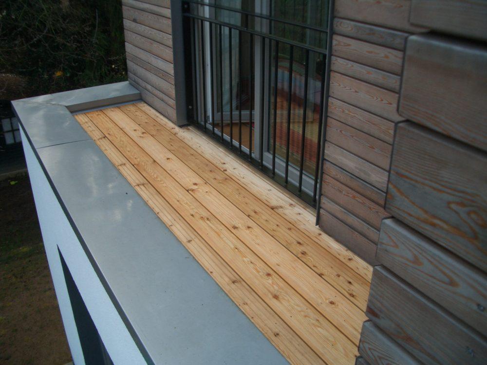 Balkon-Atikkaabdeckung aus Vorbewitterten Zinkblech Holzbau Feuerfeil